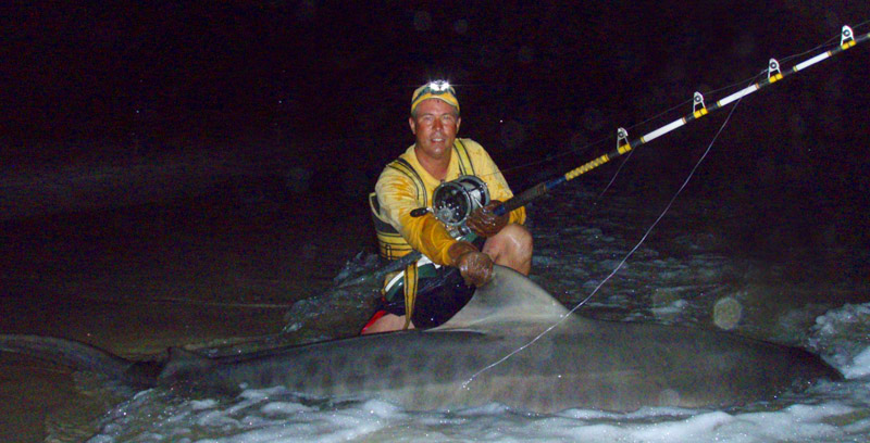Christopher Deaver with 10 foot 5 inch Tiger Shark
